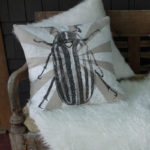 Beetle Pillow on Front Porch - June Bug