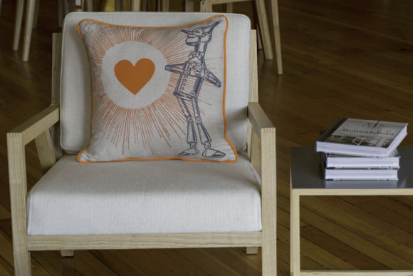 Tin Man Pillow on Modern White Chair