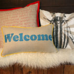 Welcome Pillow Grouped with Beetle and Words to Live By